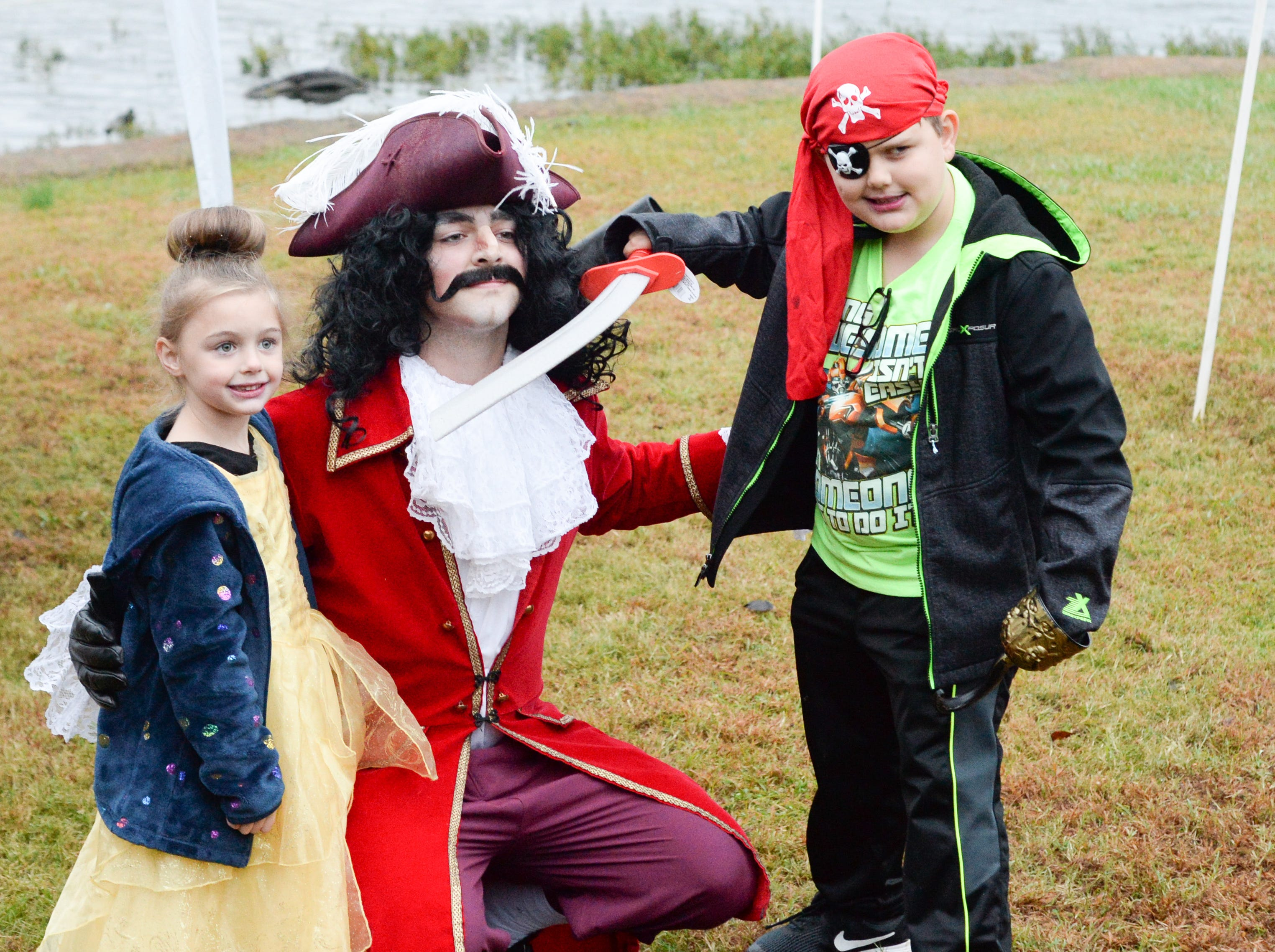 Dakota and Gavin Weyman enjoy interacting with characters during the Castle of Villains trick or treating event at Historic Rock Castle in Hendersonville on Friday, Oct. 26.