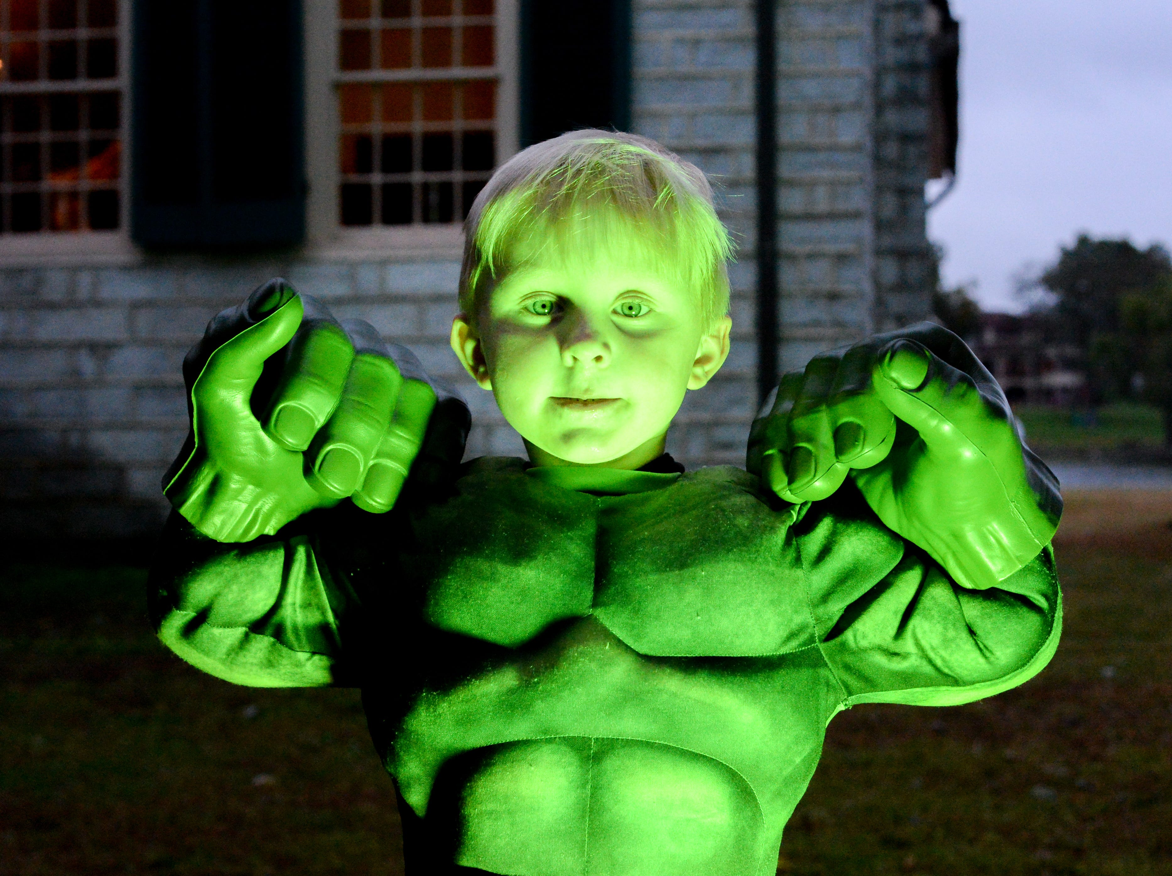 Owen Tisdale turns green during the Castle of Villains trick or treating event at Historic Rock Castle in Hendersonville on Friday, Oct. 26.