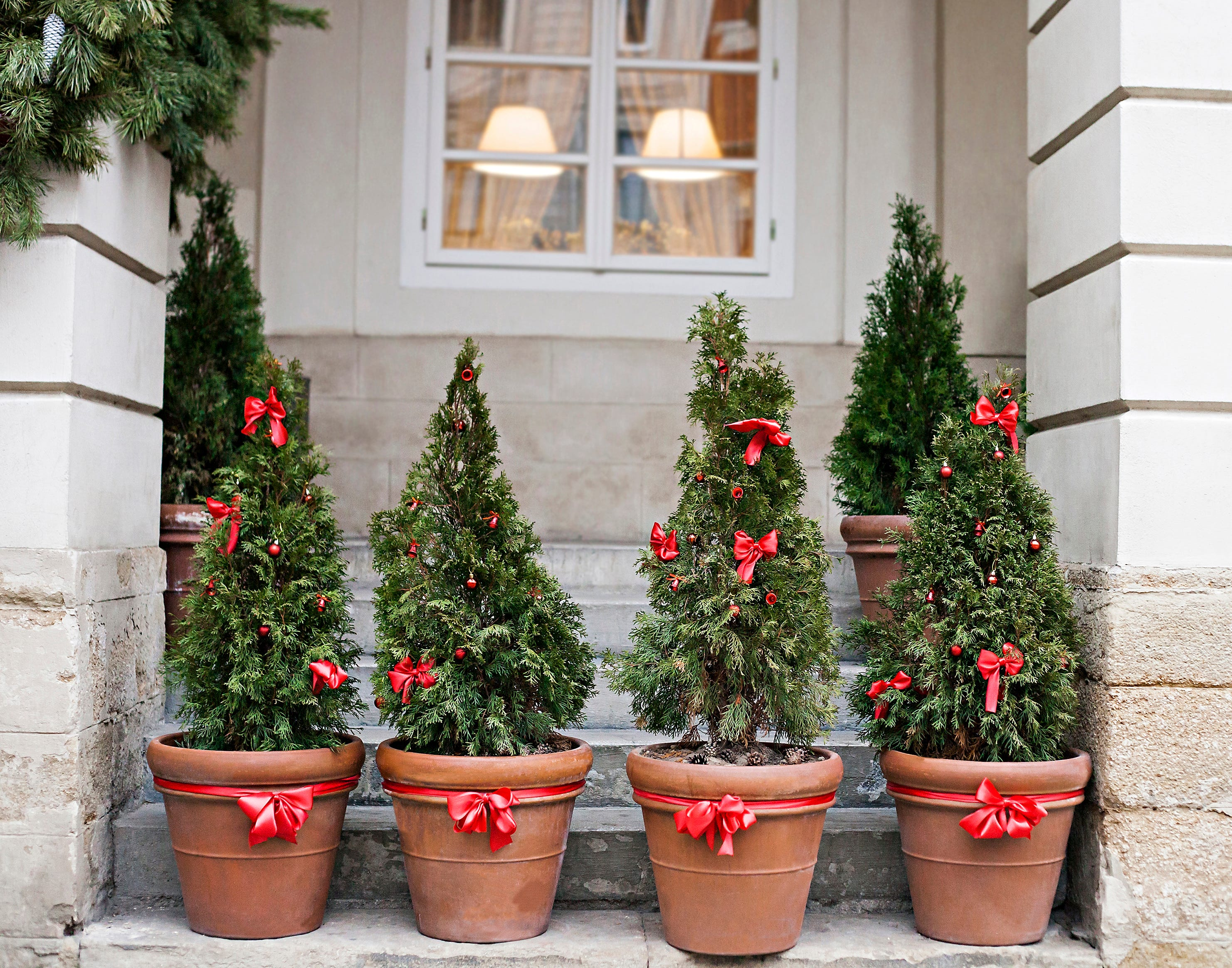 Make a lasting first impression with holiday guests with decorations outside the house.
