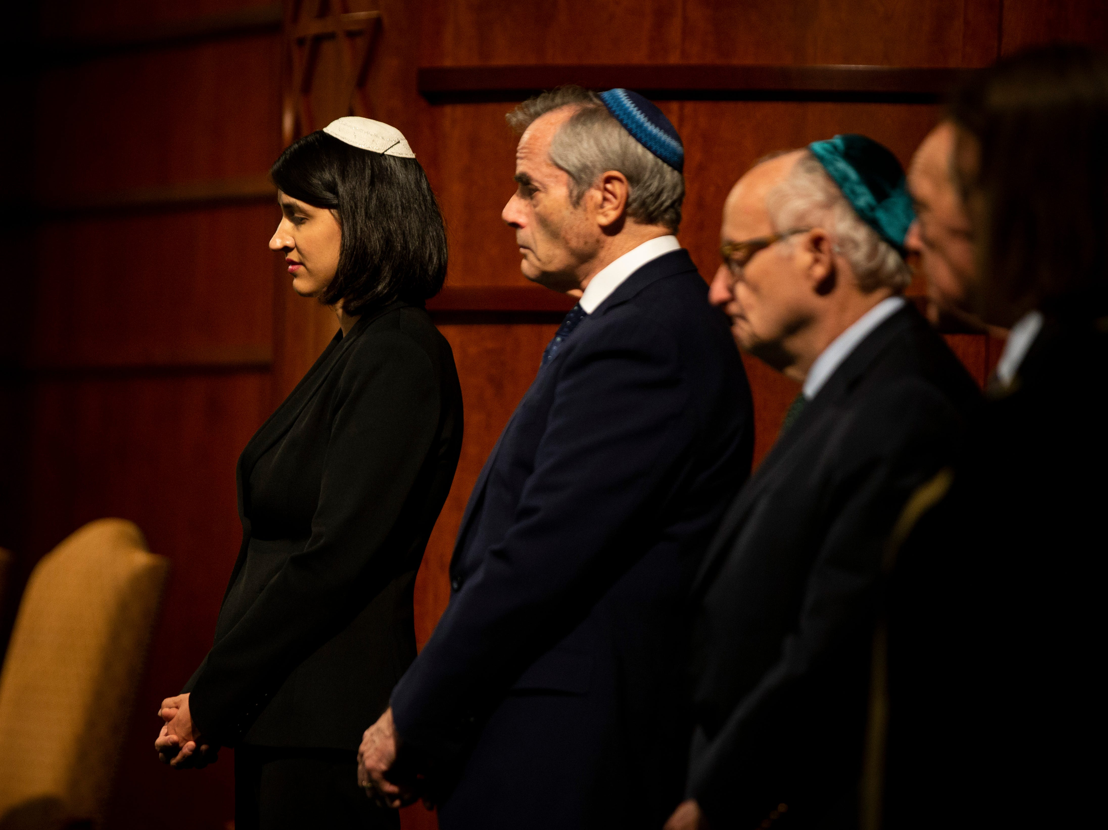 From left to right, Rabbi Nicole Luna, Rabbi Stephen Fuchs, and Rabbi James Rudin stand at the front of the room with other faith leaders during an interfaith memorial vigil on Monday, October 29, 2018, at Temple Beth-El in Fort Myers. Rabbi Rudin, who was born in Pittsburgh and still has family in Squirrel Hill, says this tragedy is personal to him.