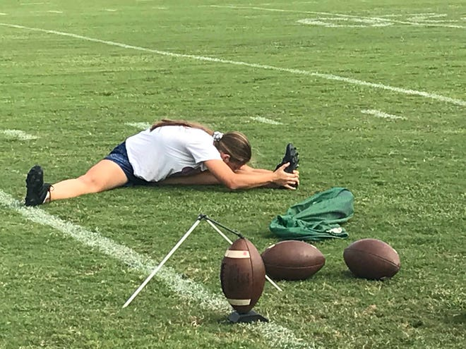 St. John Neumann freshman kicker Katie Reinert stretches before practice Oct. 23.