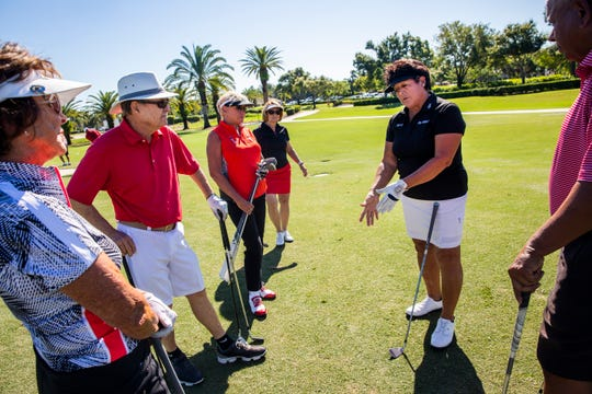 """LPGA legend Nancy Lopez talks with Connie Malenick, from left, Bob Holmes, Sis Van Dorn, and Susan Smith during a short-game clinic before the start of the """"Battle of the Sexes"""" two-day fundraising event for Swinging With Purpose at the Quail West Golf and Country Club in Naples on Monday, Oct. 29, 2018."""