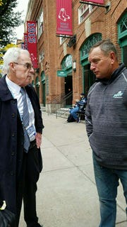 FGCU coach Dave Tollett (right), the only person to offer Red Sox ace Chris Sale a scholarship, talks with MLB.com's Peter Gammons prior to Tuesday night's World Series Game 1 in Boston that Sale started.