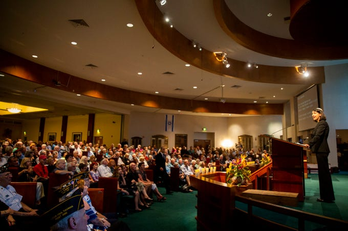Rabbi Nicole Luna speaks to the congregation during an interfaith memorial vigil on Monday, October 29, 2018, at Temple Beth-El in Fort Myers. The vigil was was organized in memory of the 11 people that died in a mass shooting at the Tree of Life synagogue in Squirrel Hill, Pennsylvania, Saturday morning.