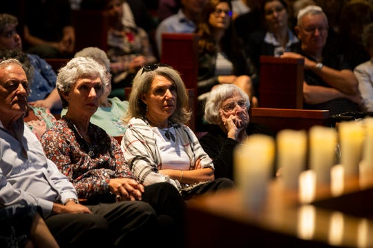Members of the congregation listen to Rabbi Nicole Luna speak during an interfaith memorial vigil on Monday, October 29, 2018, at Temple Beth-El in Fort Myers.