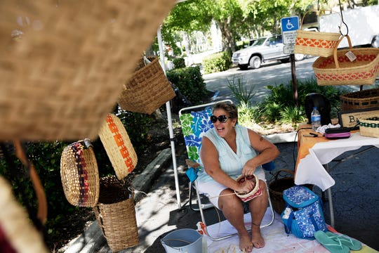 Nancy Weeks weaves a basket at her booth called Woven Wonders at the Third Street South Farmers Market on Saturday, August 13, 2016.