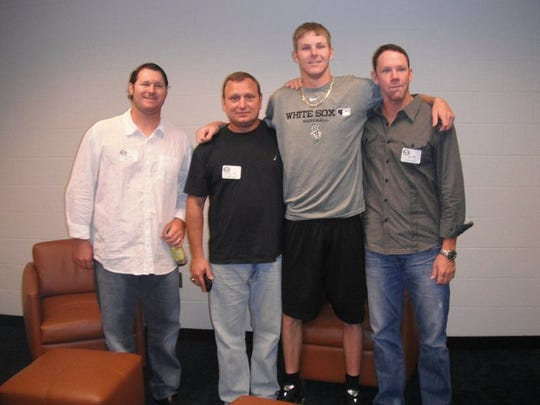 FGCU coach Dave Tollett (black shirt) and former longtime assistant Rusty McKee (far left) with Chris Sale not long after he got drafted by the Chicago White Sox in 2010.