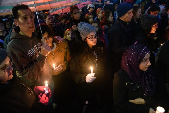 Mourners participate in a vigil on Saturday evening in the Squirrel Hill neighborhood of Pittsburgh, where 11 people were killed in a mass shooting earlier in the day at the Tree of Life Synagogue.
