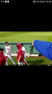FGCU coach Dave Tollett (blue arm) points at his former pitcher, Red Sox All-Star Chris Sale, who answers with an air knucklebump before Game 1 of the World Series.