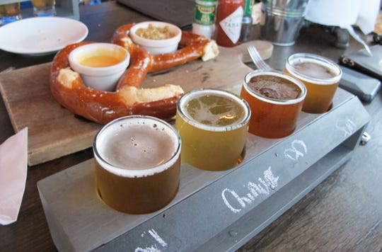 A flight of craft beers at the new Bone Hook Brewing Co. in North Naples.