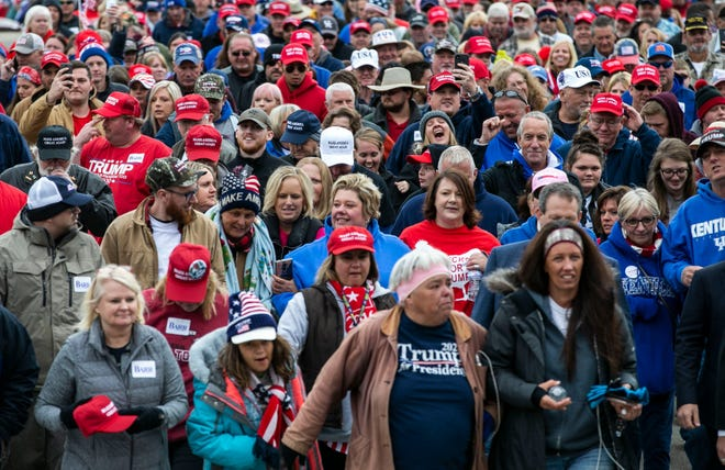 A line of thousands walked toward Alumni Coliseum in Louisville, Ky., earlier in October in anticipation of President Donald Trump's speech.