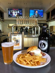 A Chevelle Burger with bacon at the bar of the new Bone Hook Brewing Co. in North Naples.