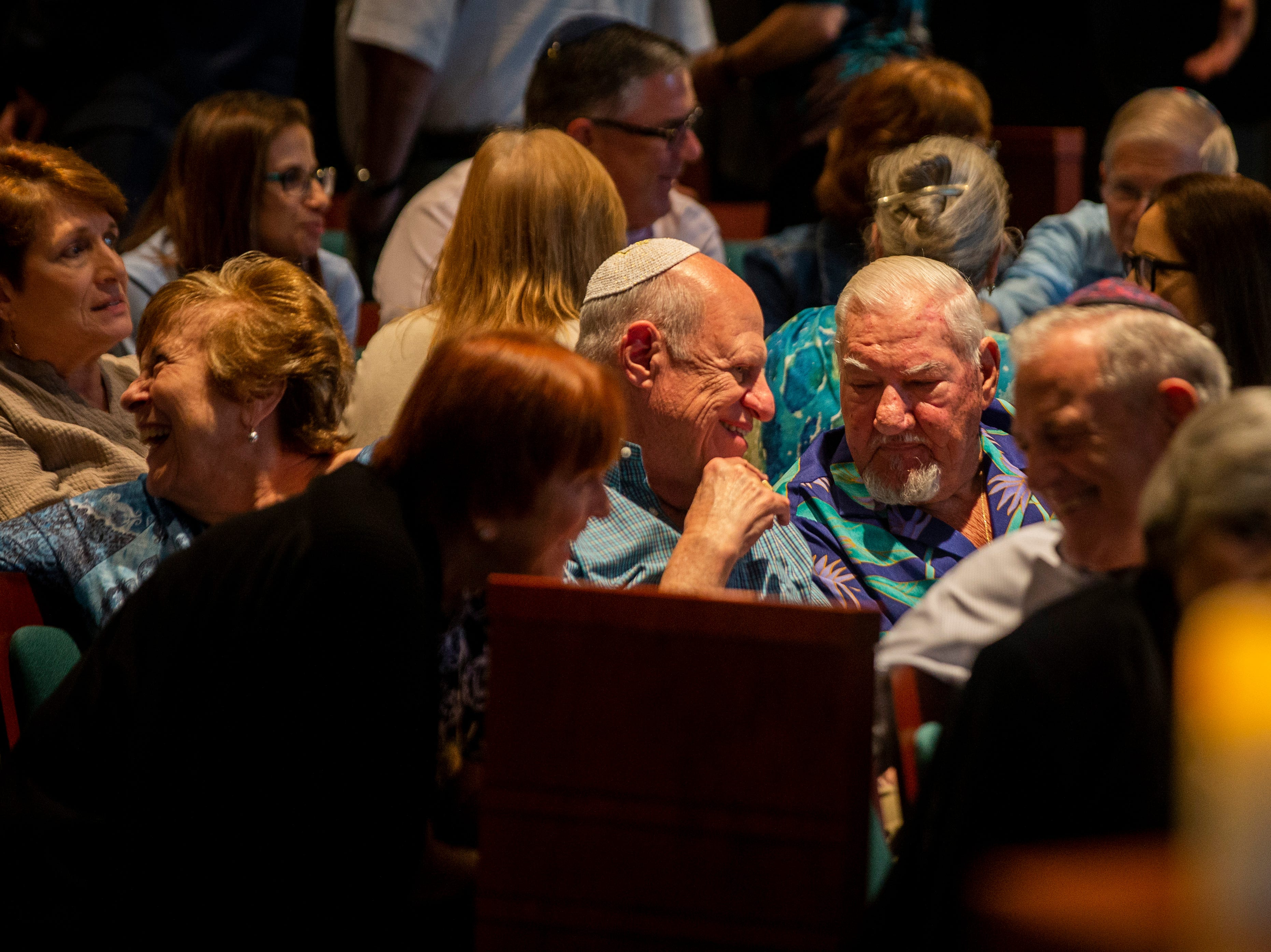 Members of the congregation introduce themselves to people they don't know after being instructed to do so by Rabbi Nicole Luna on Monday, October 29, 2018, at Temple Beth-El in Fort Myers. Rabbi Luna said in the opening of the service that an integral step to building a strong community is getting to know the people around you.