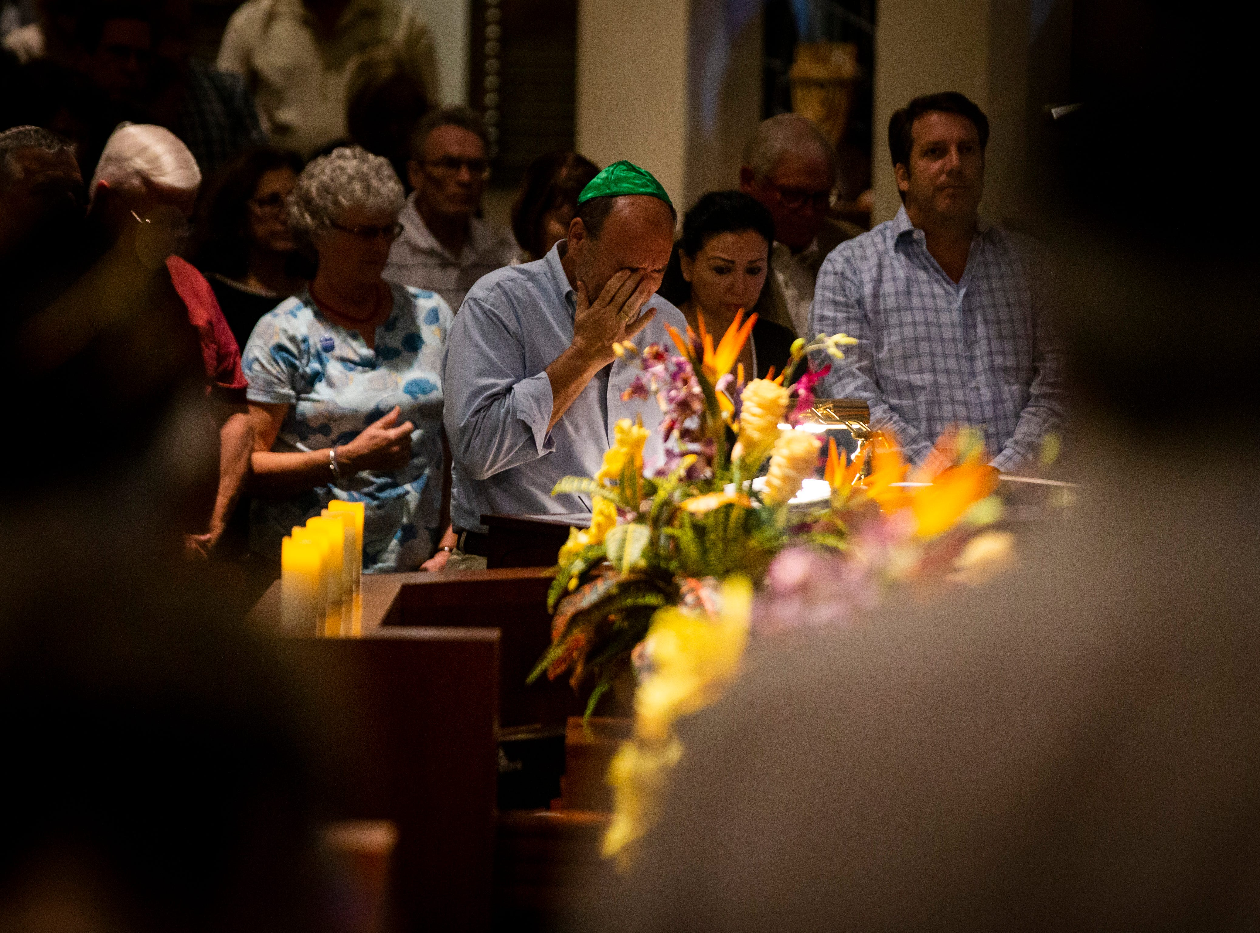 A congregant wipes his eye during an interfaith memorial vigil on Monday, October 29, 2018, at Temple Beth-El in Fort Myers.