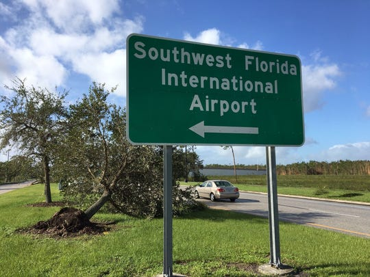 A sign points the way to the Southwest Florida International Airport.