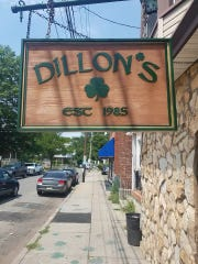 The signage for Dillon's, a favorite neighborhood watering hole