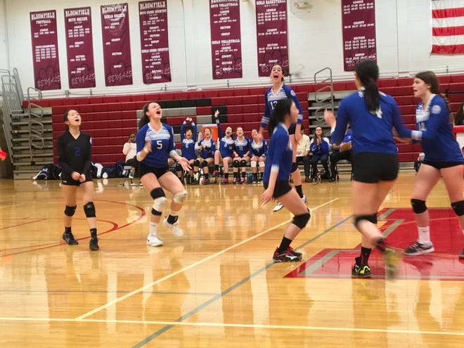 Millburn volleyball celebrates a point in its first-ever county semifinal appearance.