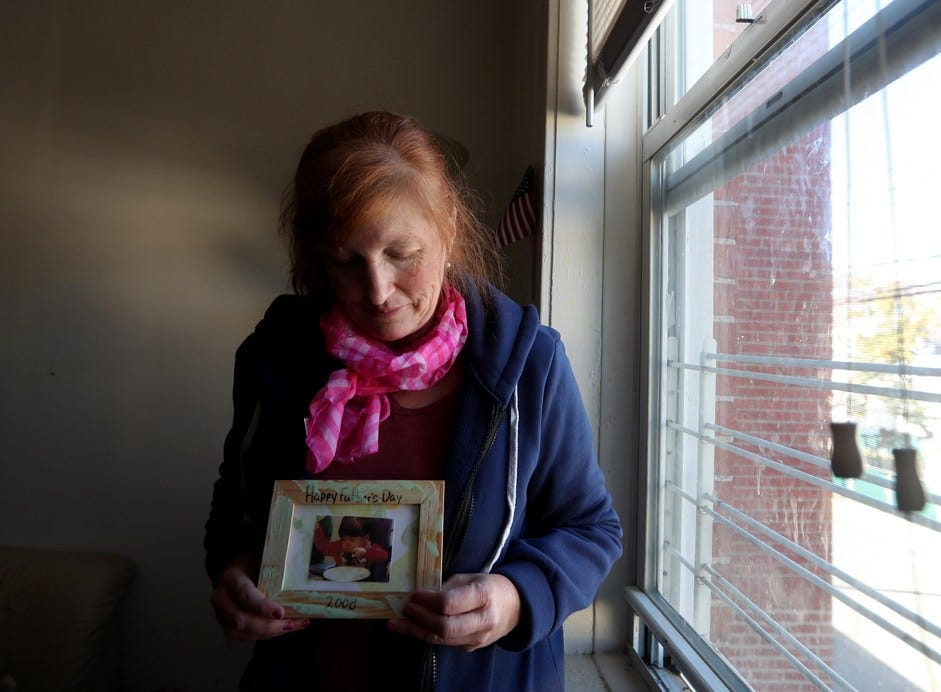 Kristine Deleg of Ossining looks at a photograph of her daughter Elizabeth Poulos. Elizabeth, 16, was one of seven residents of the Wanaque Center for Nursing and Rehabilitation who died after an outbreak of audenovirus at the facility.