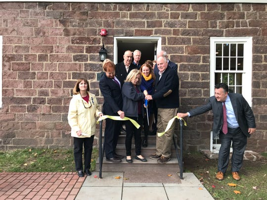 "Passaic County Freeholder director Cassandra ""Sandi"" Lazzara cutting the ribbon at the Westervelt-Vanderhoef House on Monday."
