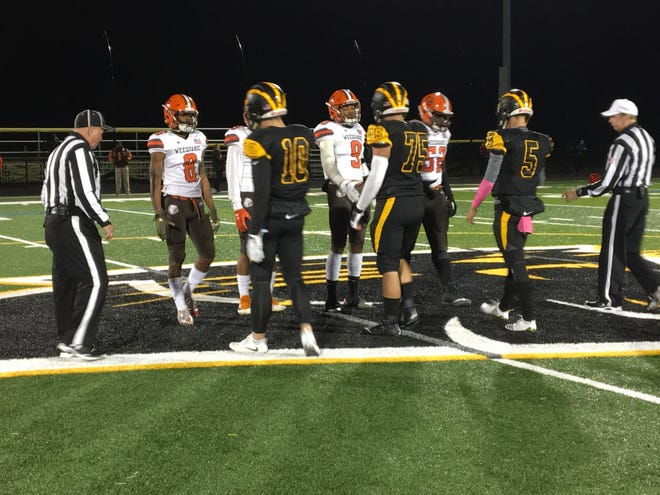 Cedar Grove captains John Guaimano (10), Joe Tanti (75) and Mike Lever (5) meet Weequahic captains for the opening coin toss.
