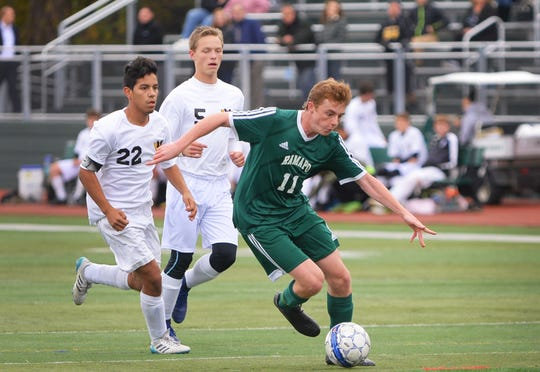 Liam Nelson (no.11) of Ramapo (in green) makes his way  against West Milford (in white) during the second half for the first round of the North 1, Group 3 tournament, at Ramapo High School field in Franklin Lakes on 10/29/18.  Ramapo won the game 6 to 1 over West Milford.