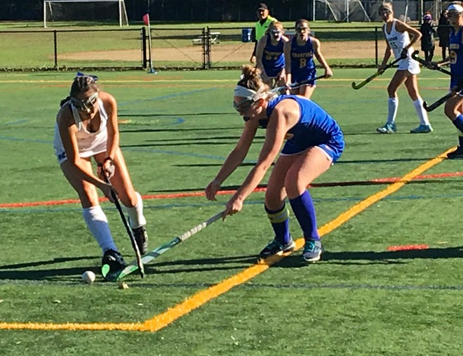 Millburn's Ella Singer (left) fights for positioning against Cranford.