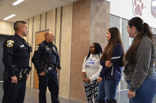 Deming Police Officers Nick Perez and Robert Chavez connecting with Deming High School students.