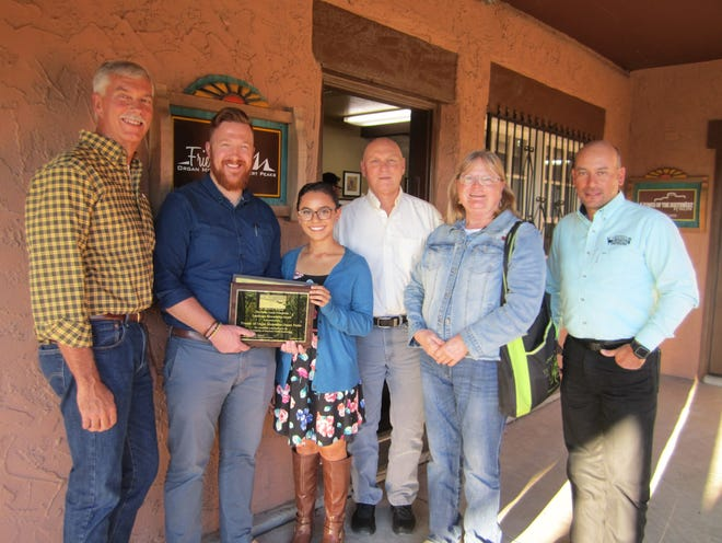 Friends of the Organ Mountains-Desert Peaks Executive Director Patrick Nolan and Associate Director Brenda Gallegos pose for a picture with Public Lands Foundation State Representative Jesse Juen, left, Bureau of Land Management Las Cruces District Manager Bill Childress, back center, PLF Director-at-Large Rosemary Thomas and Friends President Fernando Clemente.