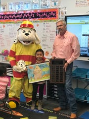 First grade student Jessica Ibarra from Mrs. Connell's class at Ocotillo Elementary won the citywide fire prevention poster contest.