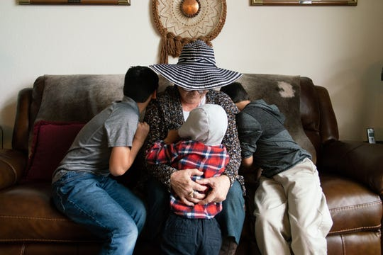 Barnes with two of her grandsons at home.