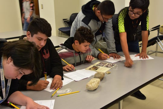 About 600 students from Carlsbad and Artesia studied fossils at six different learning stations at the National Cave and Karst Research Institute.