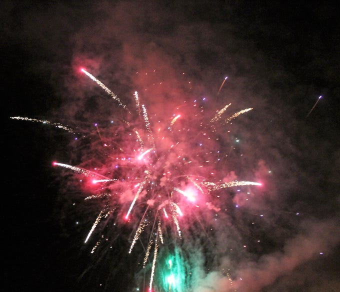 Fireworks go off at the second annual Burning of the Bull in Alamogordo Saturday.