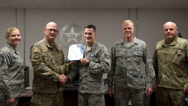 Staff Sgt. Corey S. Radel, 49th Maintenance Group Quality Assurance inspector, was awarded a Chief's Choice Award by Chief Master Sgt. Eric Corvin, 49th Maintenance Group Quality Assurance chief Oct. 19 at Holloman Air Force Base, N.M.