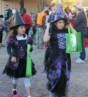 Two witches go trick or treating at Halloween Off Granado in Tularosa in 2018.
