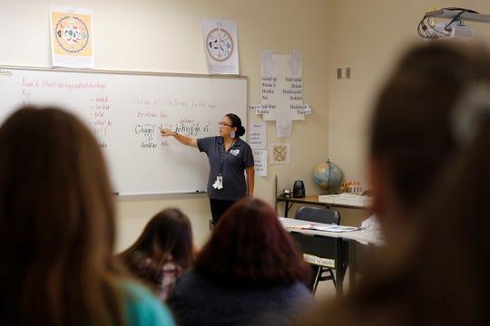 Navajo Preparatory School teacher Kimberly Becenti reads a sentence written in the Navajo language on Monday.
