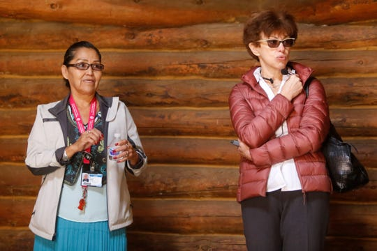 Beverly Nelson, health assistant for Navajo Preparatory School, talks about the role of the hogan in Navajo culture. Her explanation was interpreted into the Russian language by Language Interpreter Elena Goldis, right.