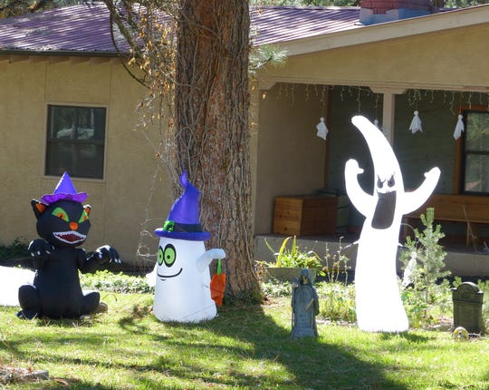 Happy Halloween characters on a lawn in Ruidoso.