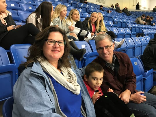 Heather and Brett Stacey of Wixom enjoy the Sensory Friendly Game with their 8-year-old son Brett, Jr. who suffers from autism.