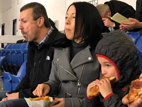 From left, Rob, Rebecca and Johnny Stojcevski of Canton watch Sunday's Sensory Friendly Game. Johnny, 7, has autism.