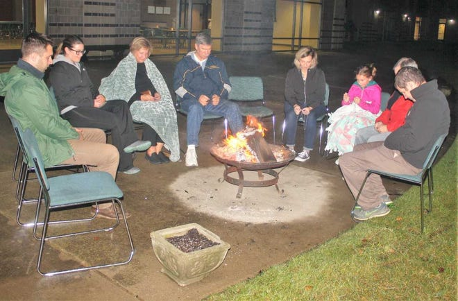 Several members of Plymouth's Our Lady of Good Counsel congregation braved cold and damp conditions Sunday night to raise money for the homeless.