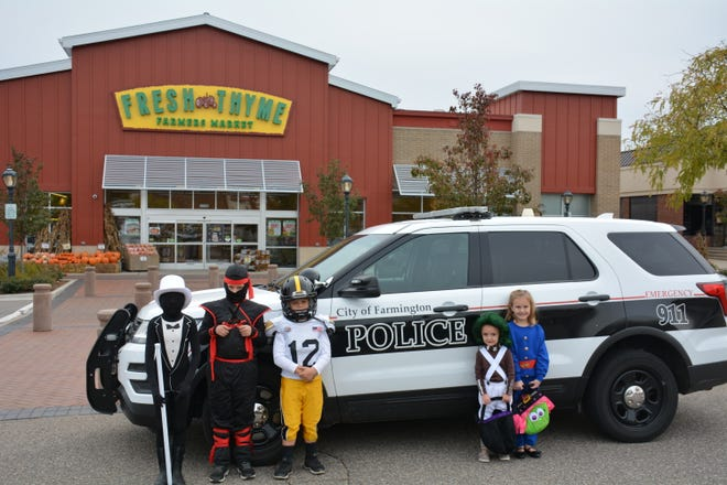 """Halloween """"Trick or Treaters"""" Caden, 8, Nolan, 8, Grant, 7, Quinn, 3, and Reese, 5 are pictured in front of Fresh Thyme Farmer's Market in downtown Farmington. Fresh Thyme Farmer's Market donated the bags of snacks for Halloween """"trick or treaters."""""""