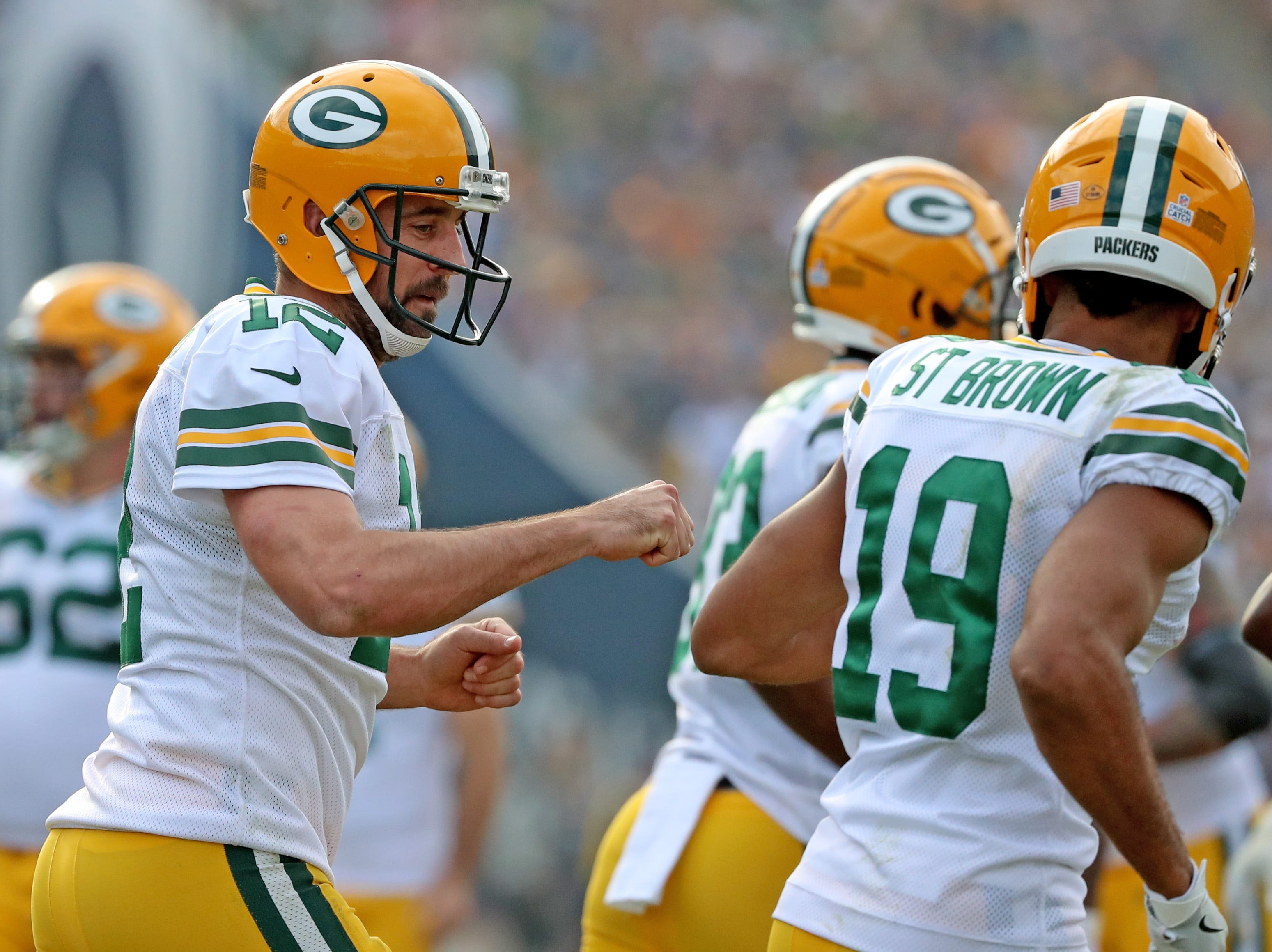 Green Bay Packers quarterback Aaron Rodgers (12) looks for a fist bumps after throwing a touchdown pass to wide receiver Marquez Valdes-Scantling (83) against the LA Rams Sunday, October 28, 2018 at the Memorial Coliseum in Los Angeles.