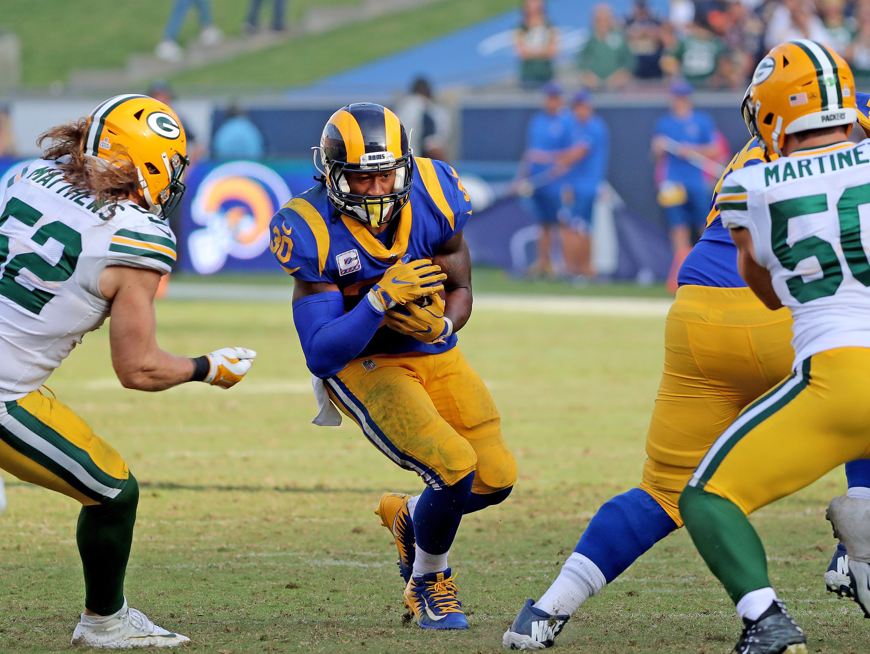 Green Bay Packers linebacker Clay Matthews (52) tries to close the hole against the LA Rams running back Todd Gurley (30) Sunday, October 28, 2018 at the Memorial Coliseum in Los Angeles.