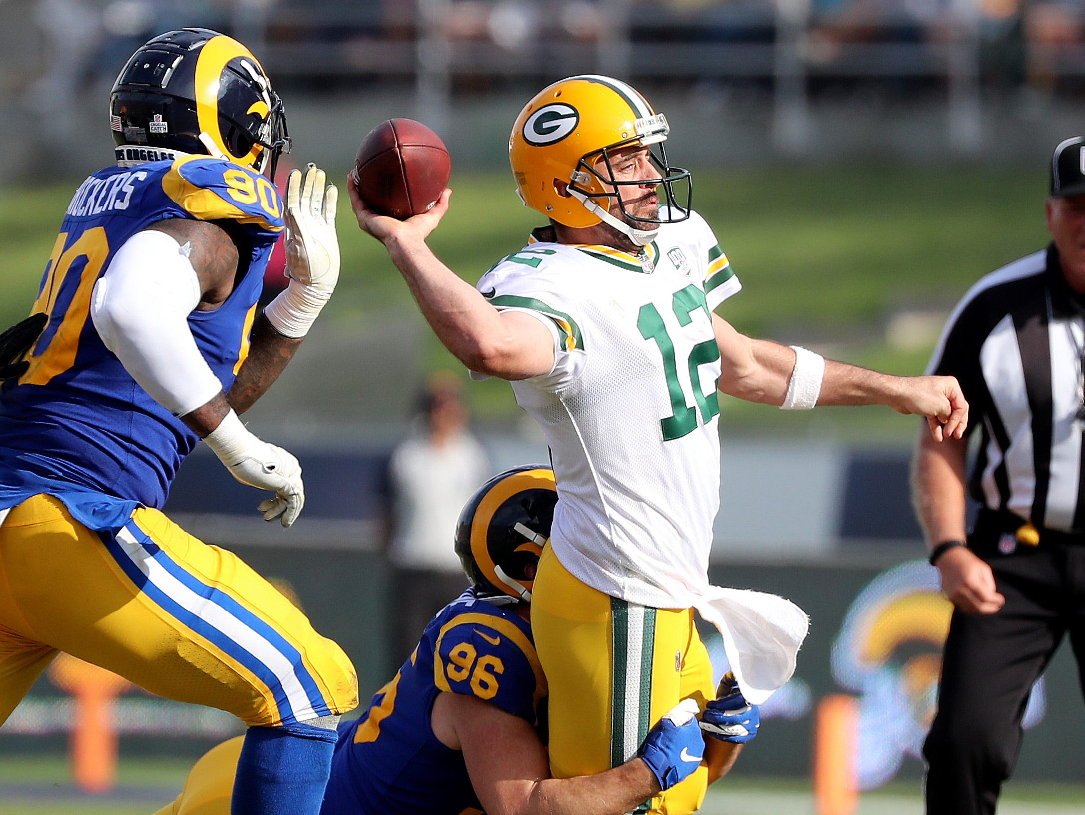 Green Bay Packers cornerback Jaire Alexander (23) throws as he is tackled by linebacker Matt Longacre (96) against the LA Rams Sunday, October 28, 2018 at the Memorial Coliseum in Los Angeles.