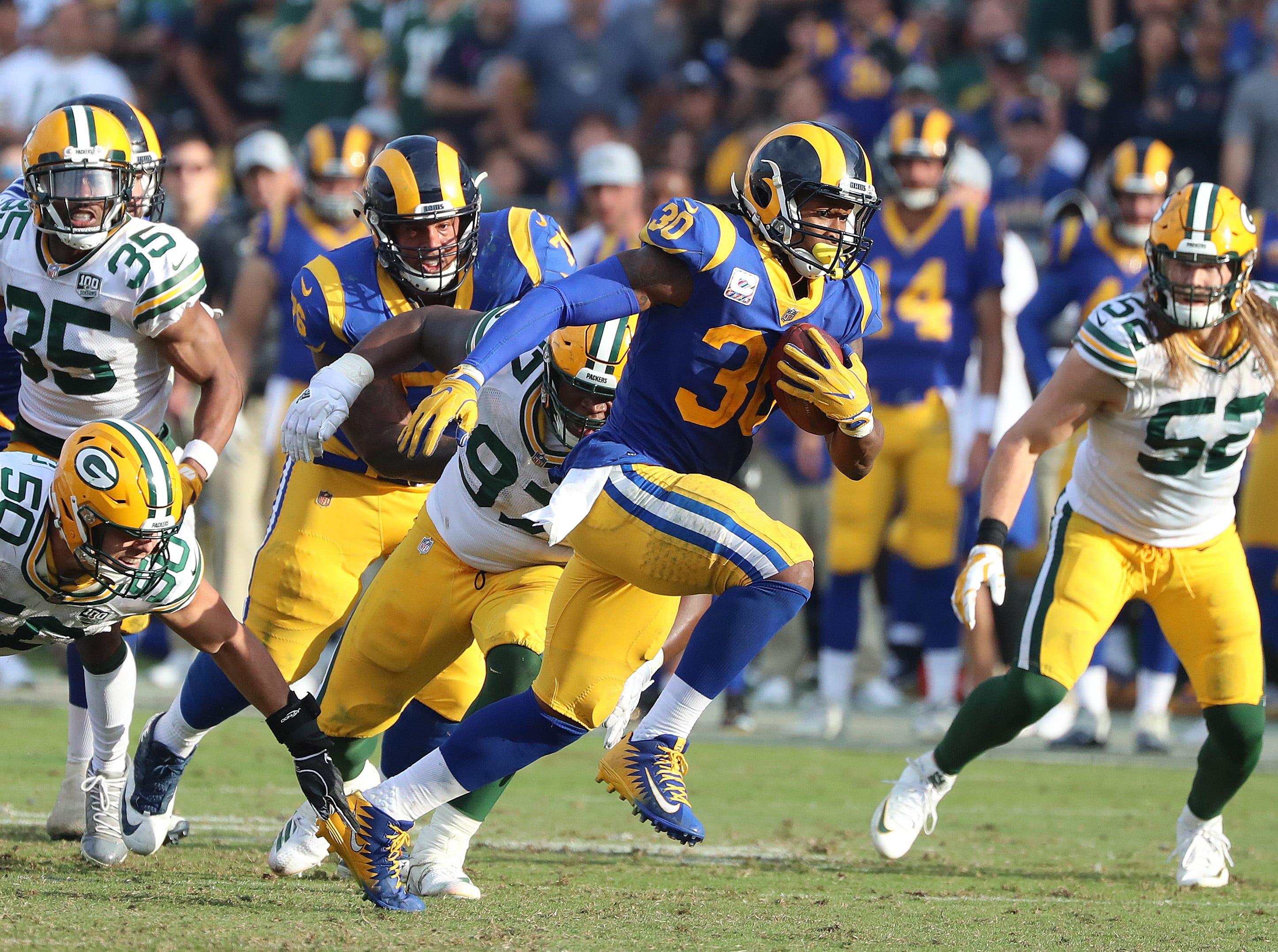 Green Bay Packers defenders watch as running back Todd Gurley (30) runs up the middle   against the LA Rams Sunday, October 28, 2018 at the Memorial Coliseum in Los Angeles.