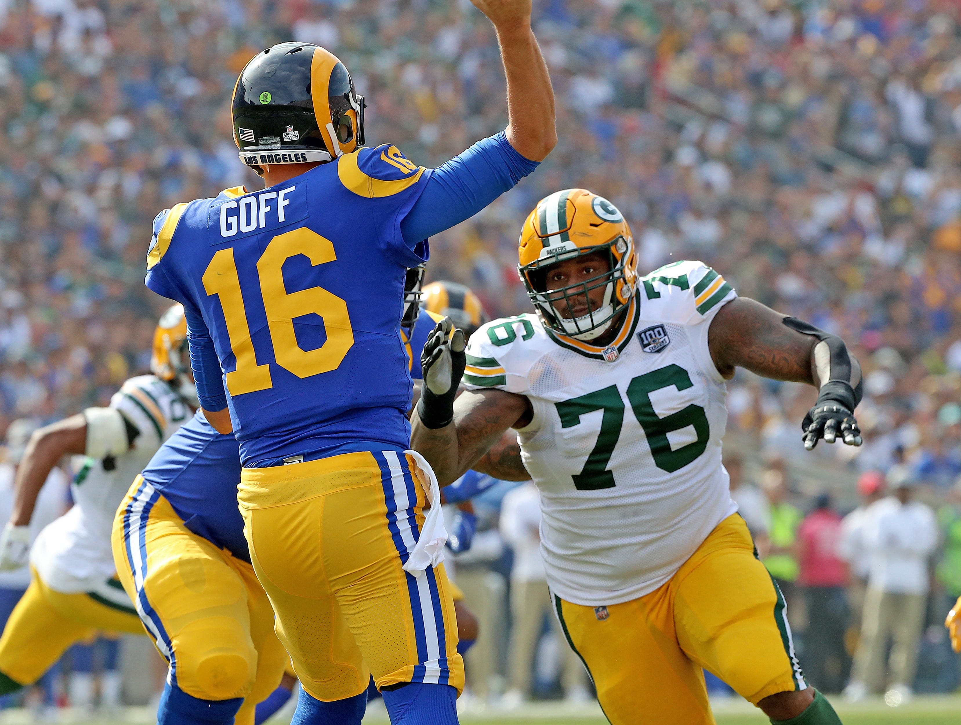 Green Bay Packers defensive tackle Mike Daniels (76) pressures quarterback Jared Goff (16) against the LA Rams Sunday, October 28, 2018 at the Memorial Coliseum in Los Angeles.