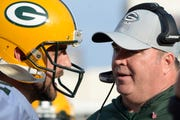 Oct 28, 2018; Los Angeles, CA, USA; Green Bay Packers head coach Mike McCarthy (right) talks to quarterback Aaron Rodgers (12) during the fourth quarter against the Los Angeles Rams at Los Angeles Memorial Coliseum.