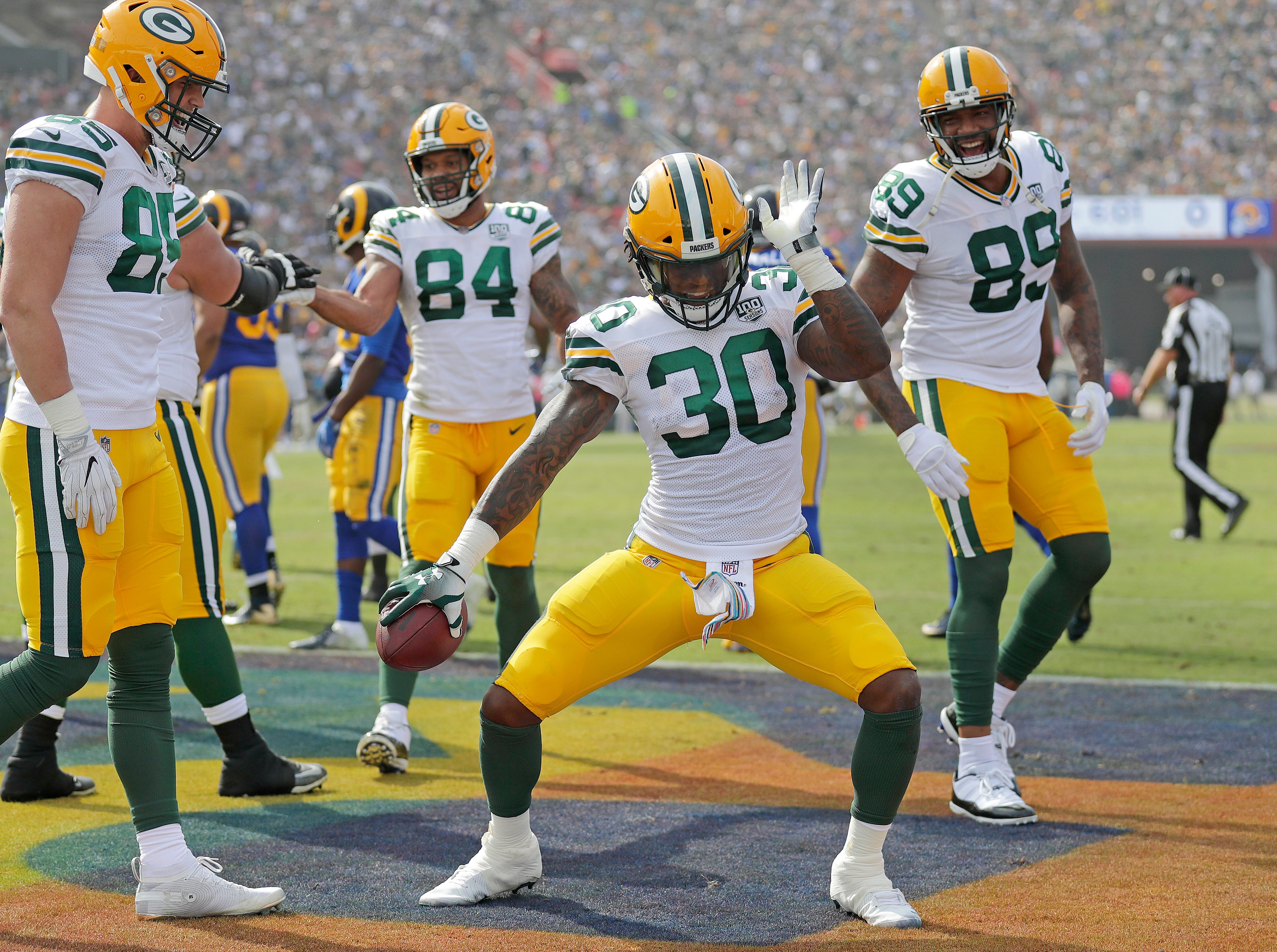 Green Bay Packers running back Jamaal Williams (30) celebrates his touchdown run against the LA Rams Sunday, October 28, 2018 at the Memorial Coliseum in Los Angeles.