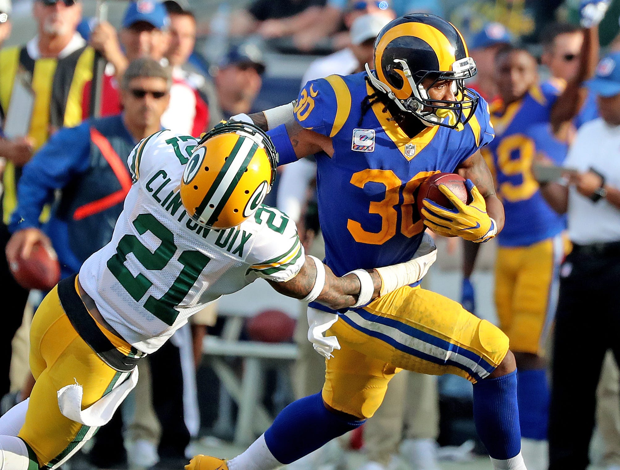 Green Bay Packers free safety Ha Ha Clinton-Dix (21) gets stiff armed and dumped by running back Todd Gurley (30) against the LA Rams Sunday, October 28, 2018 at the Memorial Coliseum in Los Angeles.