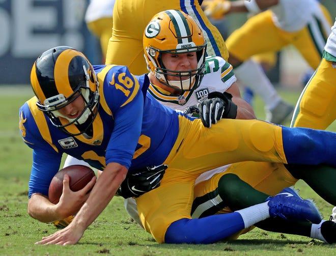 Green Bay Packers linebacker Blake Martinez (50) sacks quarterback Jared Goff (16) against the LA Rams Sunday, October 28, 2018 at the Memorial Coliseum in Los Angeles.